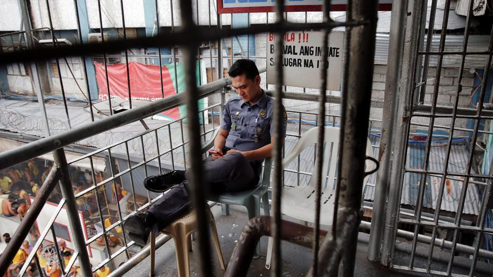 A security guard outside a jail in Philippines.