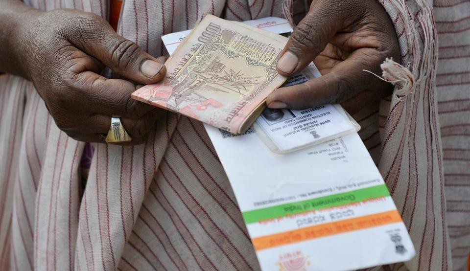People waiting to exchange demonitised Indian currency, make enquiries at the closed gates of Reserve Bank of India in Bangalore on January 2.