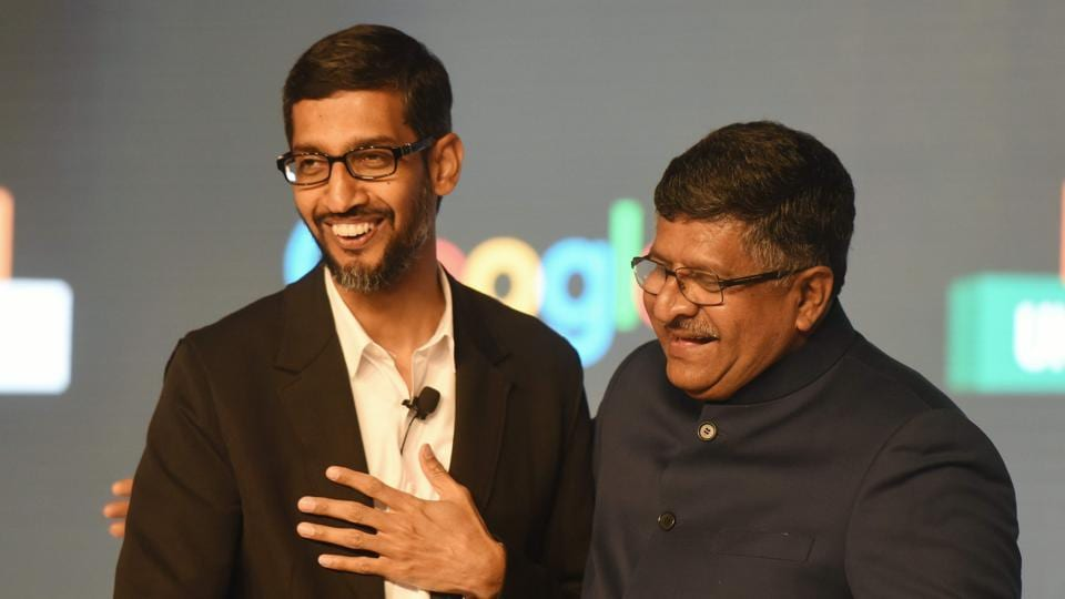 CEO of Google Inc. Sundar Pichai (L) shakes hands with union minister for information technology Ravi Shankar Prasad at the end of a meeting about partnering with small business in New Delhi on January 4, 2017.