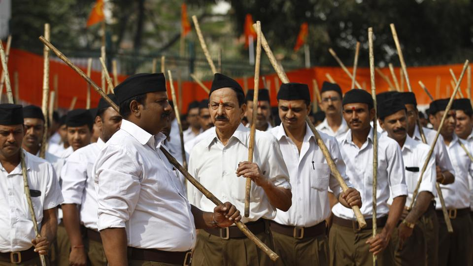 Members of Hindu nationalist Rashtriya Swayamsevak Sangh (RSS) participate in a Vijayadashami program wearing the organization's new uniform in Bangalore, in this file photo from October 23, 2016. The Sangh is now banking on icons from within its folds who advocated the virtues of equality within the Hindu communities as it readies its cadres for assembly elections in five states.