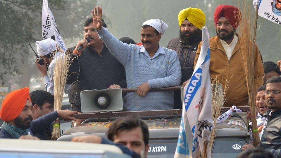 Aam Aadmi Party (AAP) leader and Delhi chief minister Arvind Kejriwal and other AAP leaders take part in a roadshow in Boparai village, near Amritsar.
