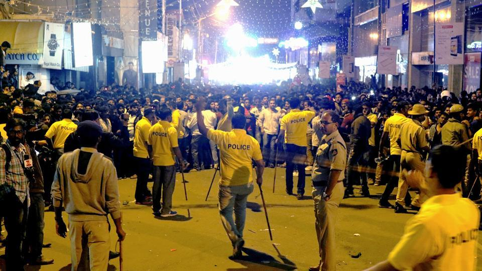 Police personnel try to manage the crowd during New Year's Eve celebrations in Bengaluru on January 1, 2017.