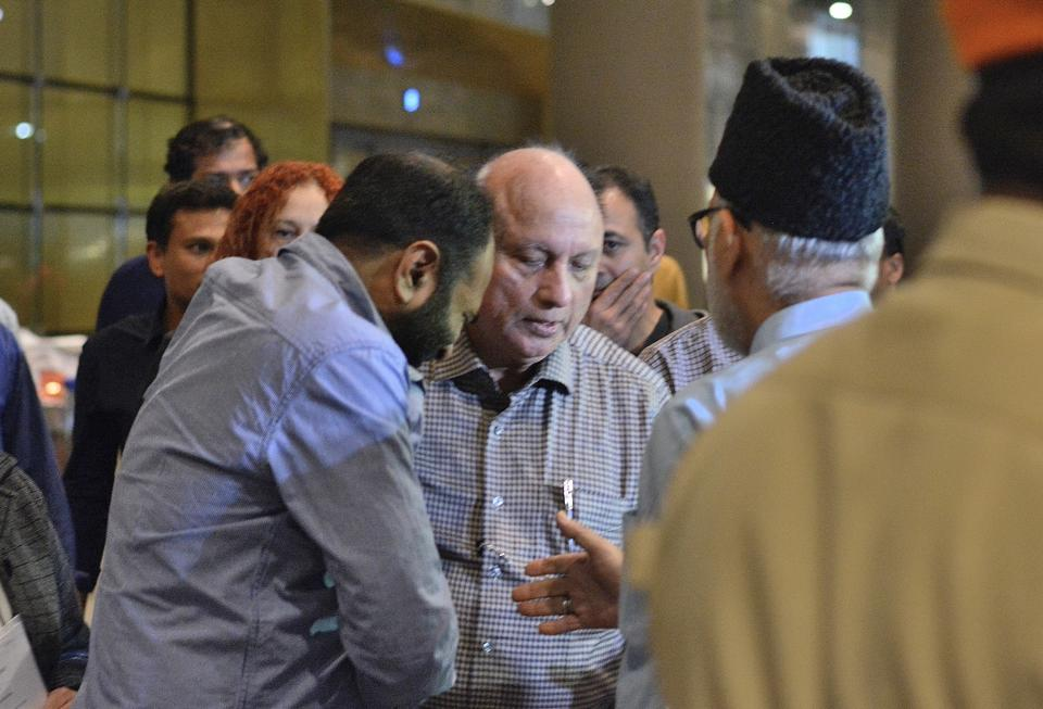 Relatives and friends offer their condolences to Abis Rizavi's father, Akhtar Rizvi, upon his arrival at the T2.