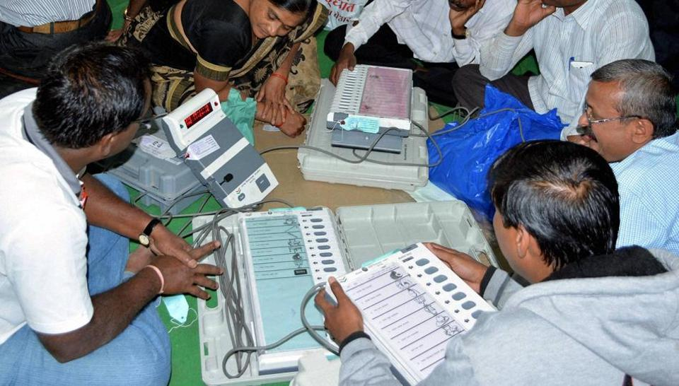 In this file photo from November 26, 2016, polling officers check electronic voting machines (EVM) after collecting them from different centres on the eve of municipal council elections in Karad. In all, some 160 million people will be eligible to vote in these five states.