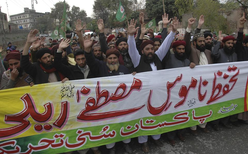 Activists from the Pakistani religious group Sunni Tehreek rally in support of blasphemy laws, in Rawalpindi, Pakistan.
