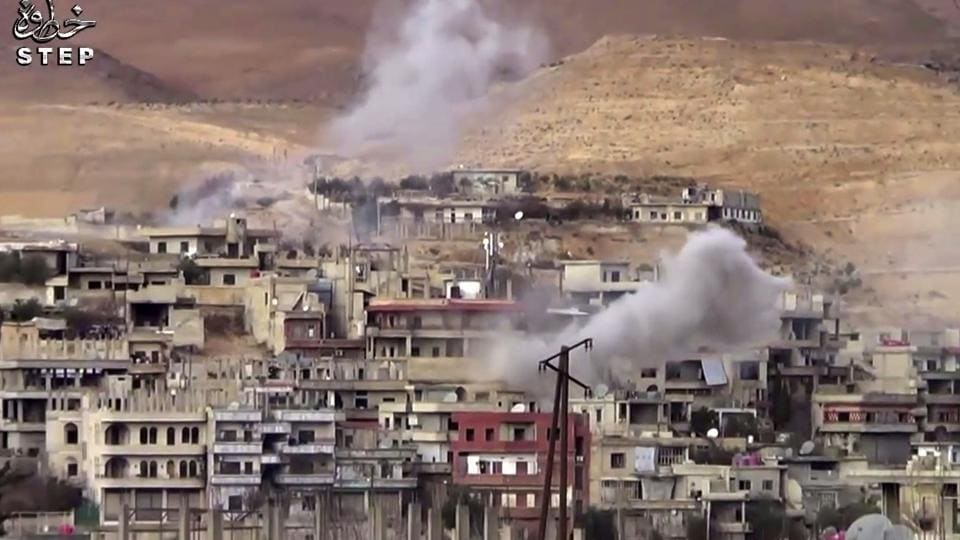 This frame grab from video provided By Step News Agency, a Syrian opposition media outlet that is consistent with independent AP reporting, shows smoke rise from the government forces shelling on Wadi Barada, northwest of Damascus, Syria.