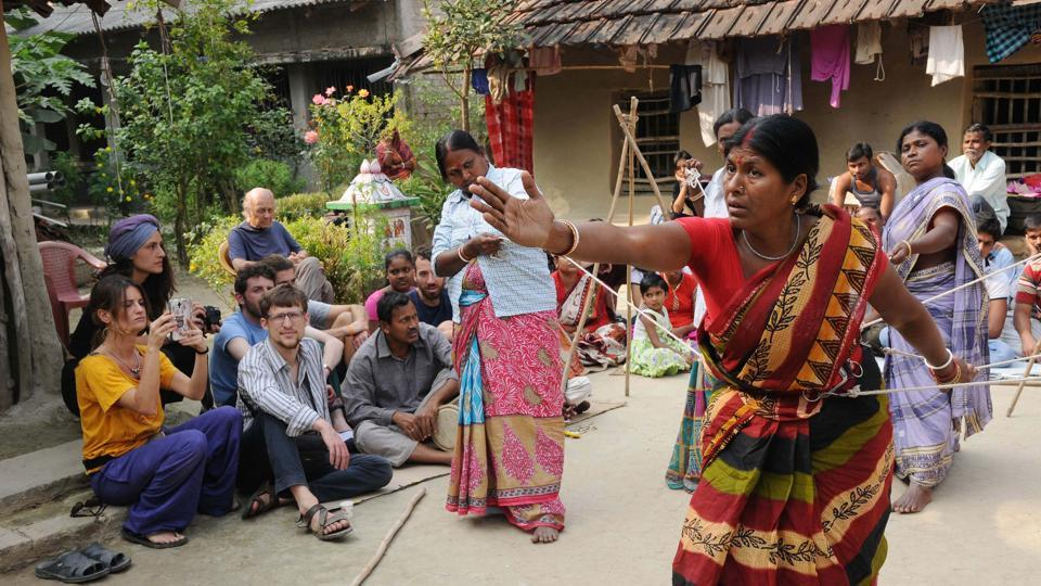 A Jana Sanskriti troupe rehearse a play seeking women's liberation from household work at Digambarpur, Sunderbans, South 24-Parganas in Kolkata .