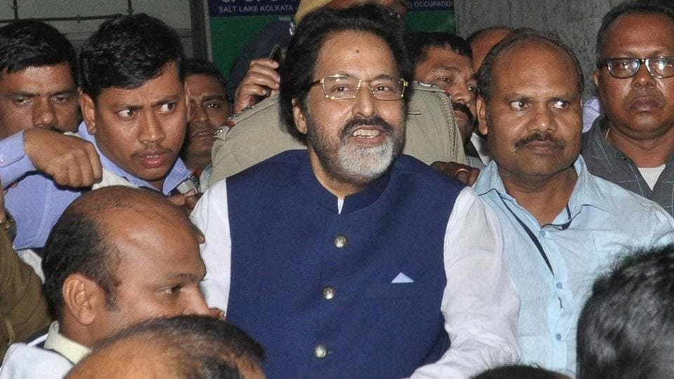 TMC MP Sudip Bandopadhyay being taken by CBI officers to Bhubaneswar for further inquiry who was arrested in connection with Rose Valley chit fund scam  in Kolkata on Tuesday evening .