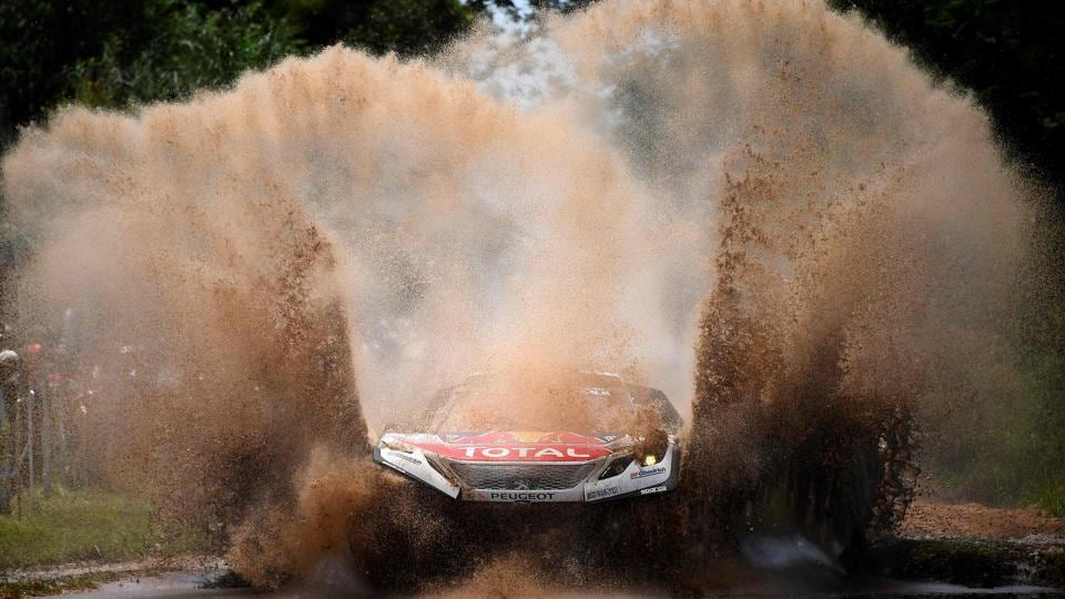 Peugeot's pilot Sebastien Loeb and co-pilot Daniel Elena, race their car through water, during the first state of the Dakar Rally 2017, between Asuncion and Resistencia, in Argentina, on January 2.  (FRANCK FIFE/ AFP Photo)