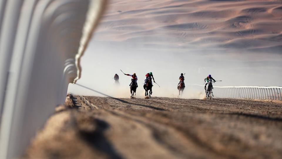 Jockeys compete in a race for purebred Arab horses during the Liwa 2017 Moreeb Dune Festival at the Liwa desert, some 250 kilometres west of the Gulf emirate of Abu Dhabi.  (Karim Sahib/AFP)