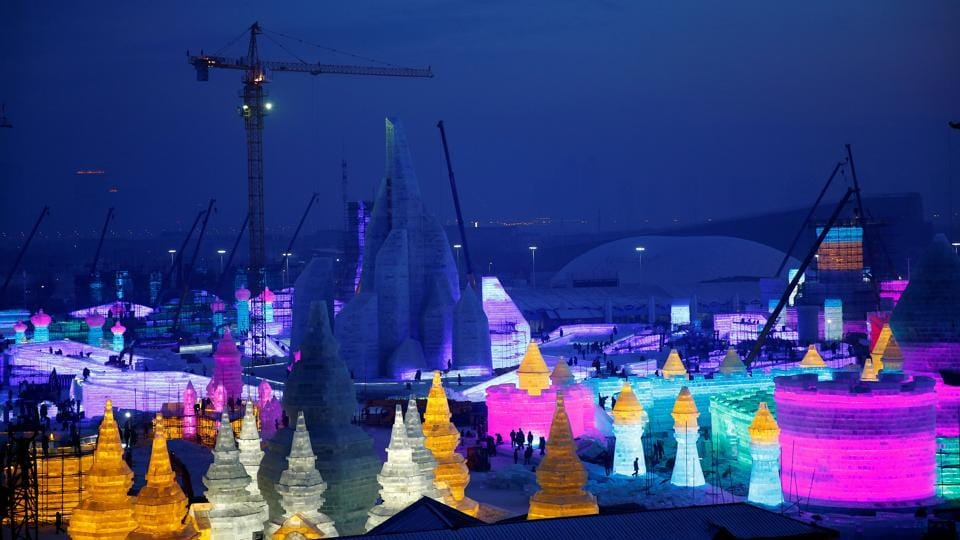 Artists and workers prepare ice and snow sculptures for the upcoming Harbin International Ice and Snow Sculpture Festival, in Harbin, Heilongjiang province, China, December 16, 2016.  (Aly Song / REUTERS)