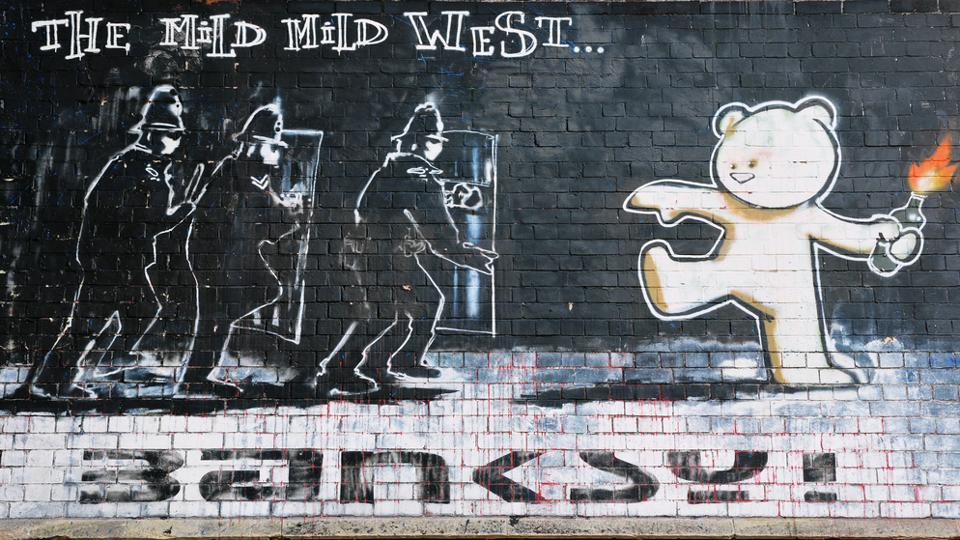 The famous Banksy piece titled Mild Mild West on a brick wall in the city centre in Bristol, UK.