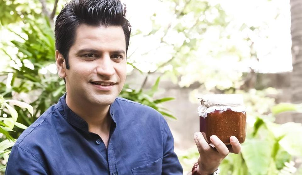 Chef Kunal Kapur holds up a jar of pickles