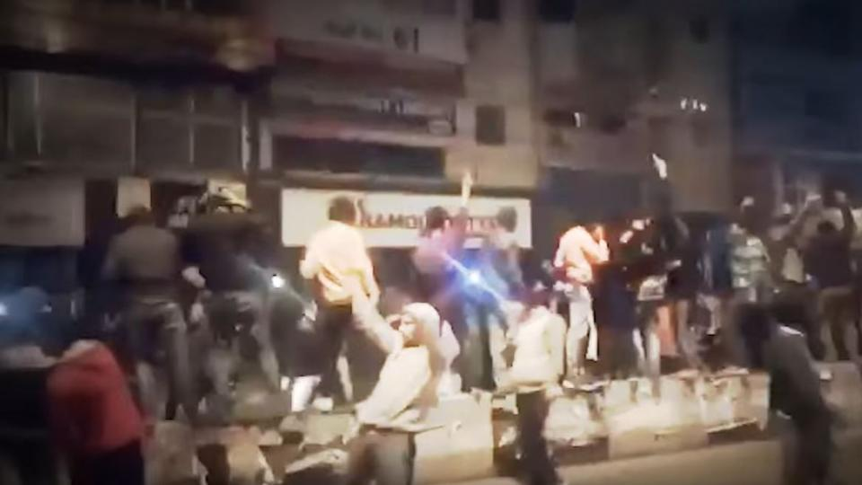 The video allegedly shows the men celebrating near Batra Cinema in Delhi.