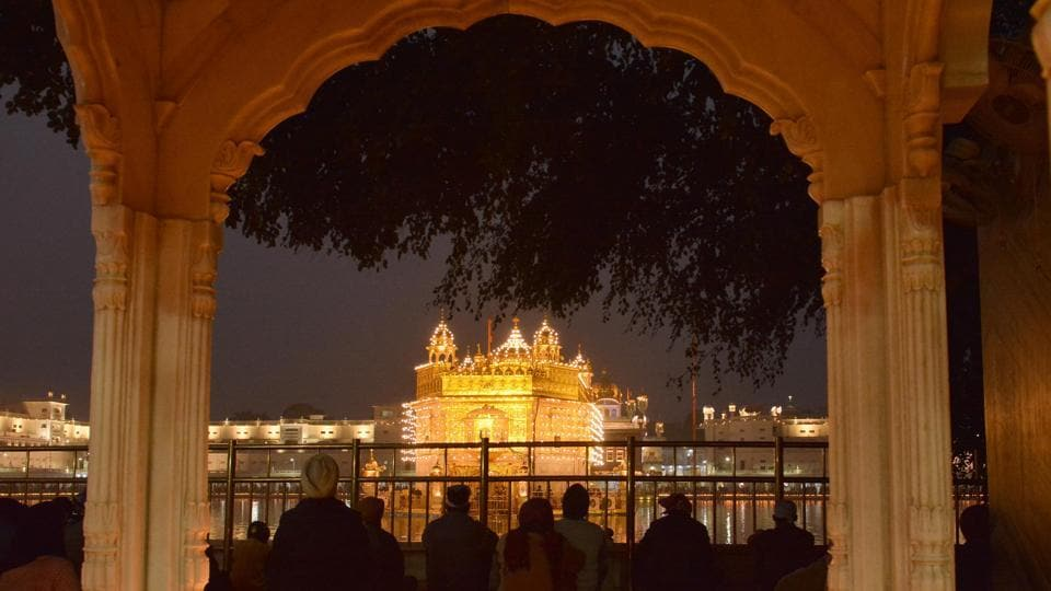 An illuminated Golden Temple on the occasion of 350th birth anniversary of Guru Gobind Singh in Amritsar on Thursday.  (Sameer Sehgal/HT Photo)