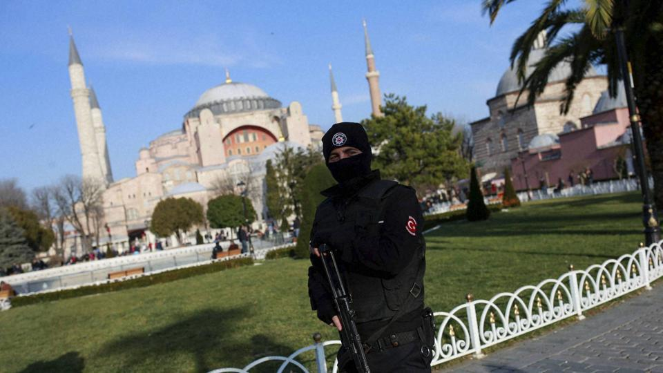 Backdropped by the Byzantine-era Hagia Sophia, one of Istanbul's main tourist attractions, a Turkish police officer patrols in the historic Sultanahmet district in Istanbul.