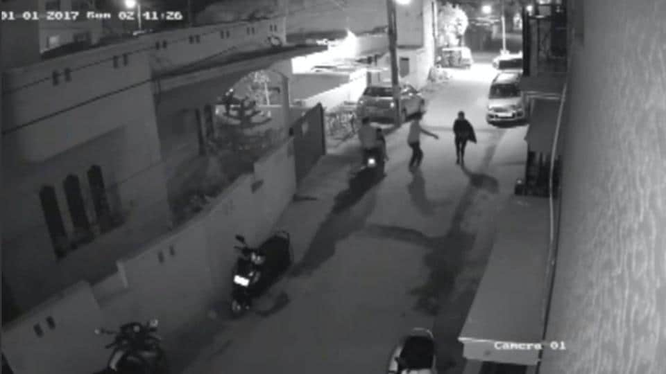 Two men on a scooter assault a woman, attempting to take off her clothes and pushing her to the ground before leaving, in Bengaluru, India, in this still image taken from January 1, 2017 CCTV footage.