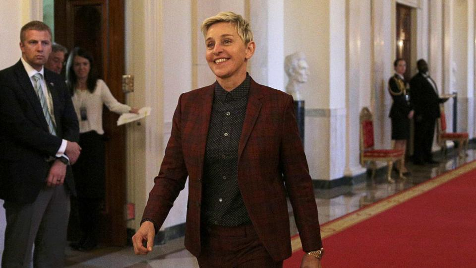 Comedian Ellen DeGeneres heads to her seat before a ceremony awarding the Presidential Medal of Freedom to various recipients in the East Room of the White House in Washington.