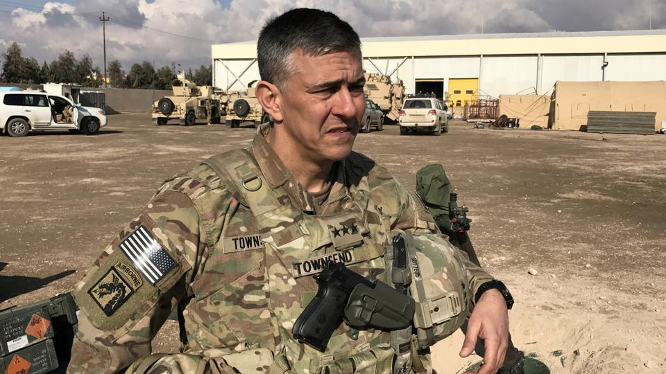 Commander of the US led coalition, Lieutenant General Steve Townsend speaks at a military base north of Mosul, Iraq, on Wednesday.