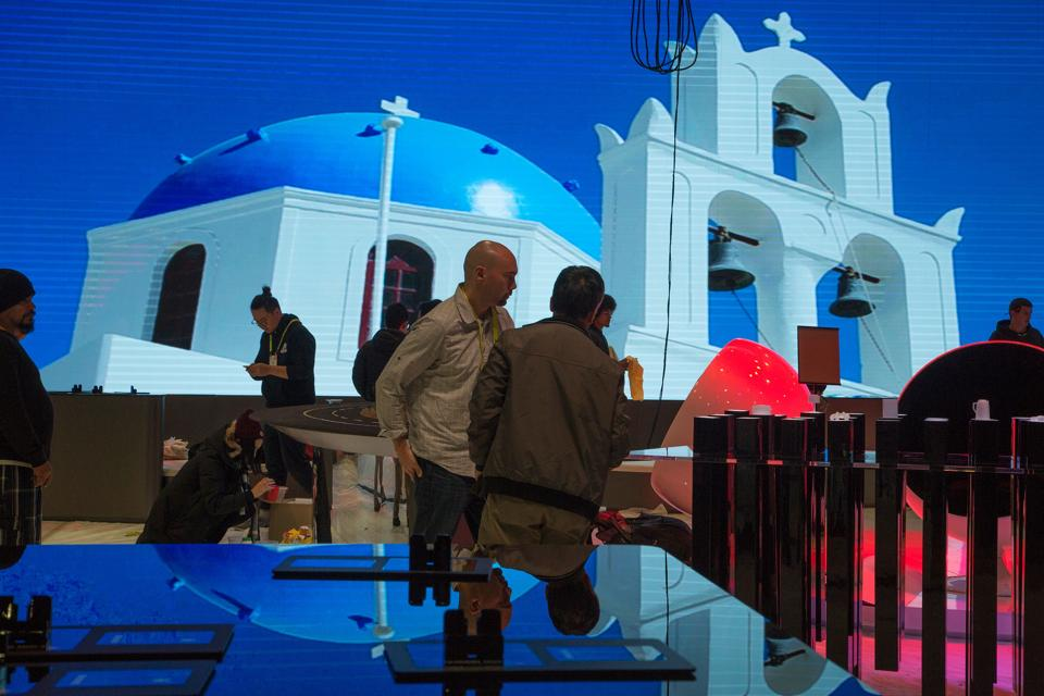 Crews construct the Huawei exhibit during the 2017 Consumer Electronics Show (CES) at the Las Vegas Convention Center in Las Vegas, Nevada.