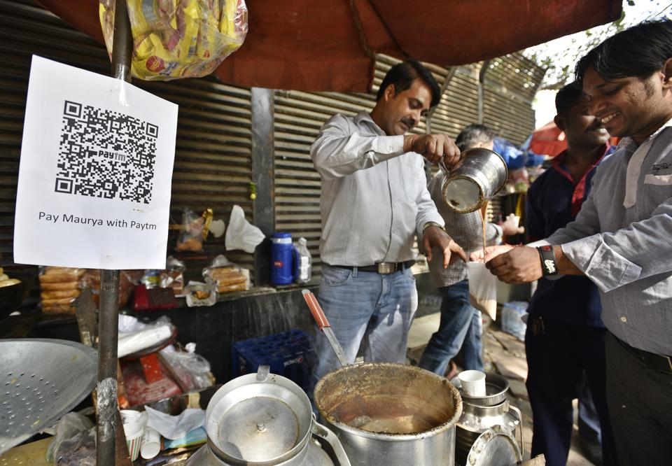 Ideas at the right time: A tea vendor in New Delhi who accepts payment through a mobile wallet