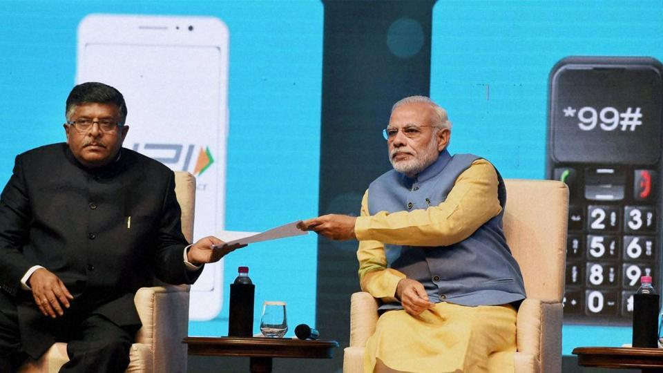 Prime Minister Narendra Modi and Union minister IT and communications, Ravi Shankar Prasad at the launch of BHIMmobile app.