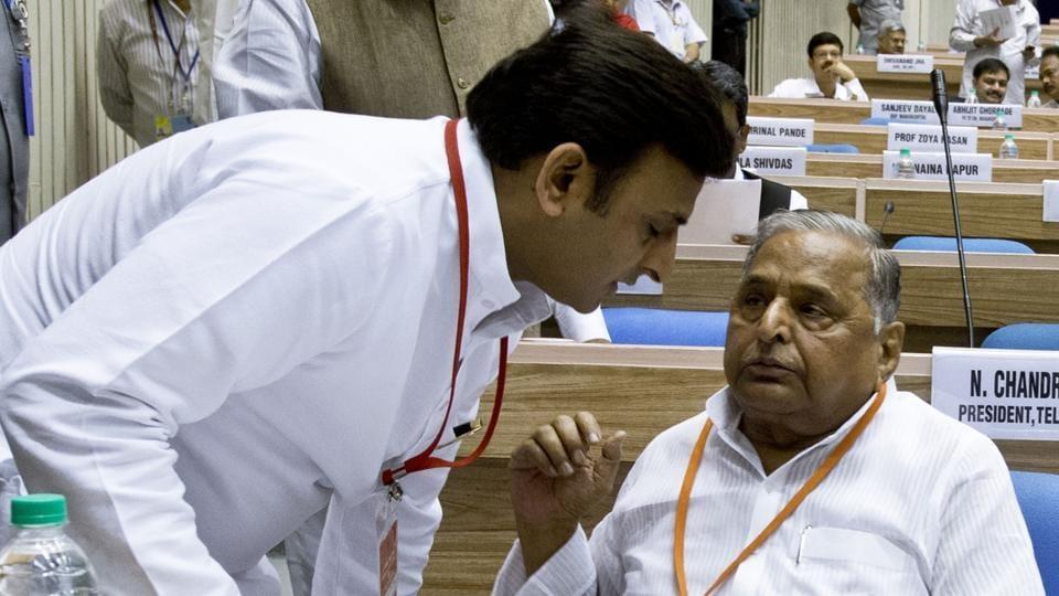 Chief minister of Uttar Pradesh Akhilesh Yadav (L) with his father Mulayam Singh Yadav.