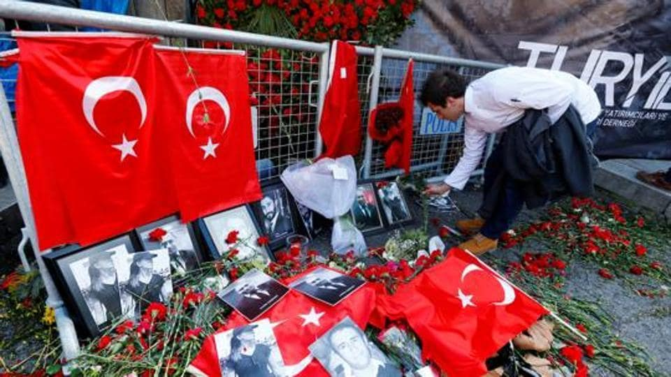 A man places flowers at the entrance of Reina nightclub, which was attacked by a gunman, in Istanbul, Turkey January 3, 2017.