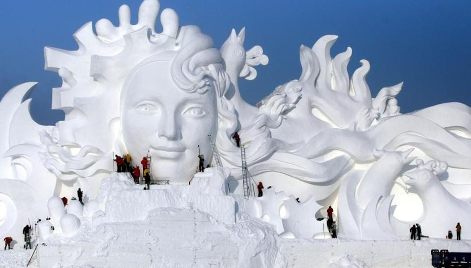Artists work on snow sculptures at an exhibition in Harbin, Heilongjiang province, China, December 13, 2016.