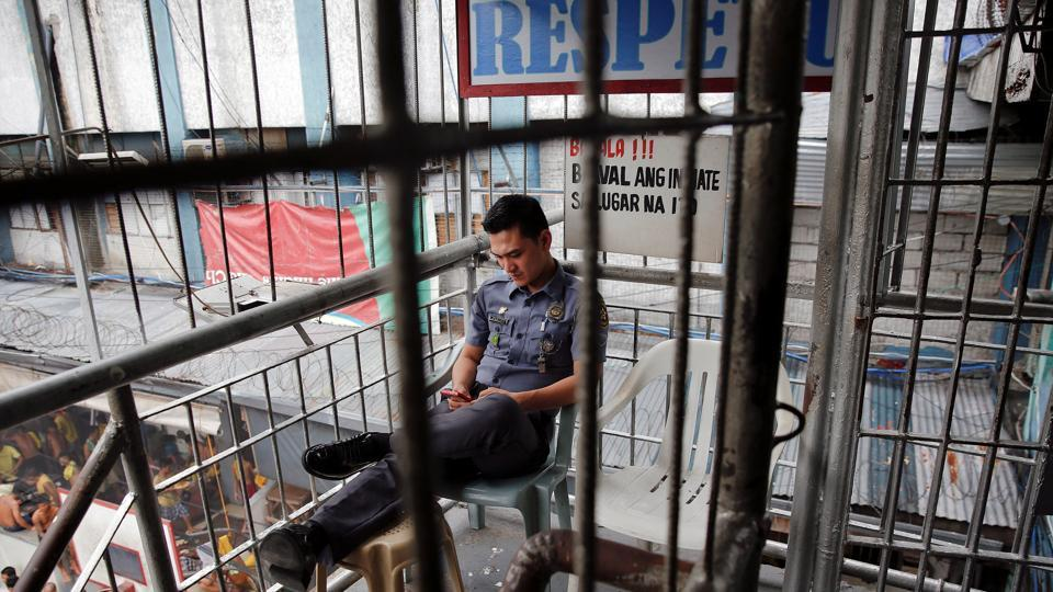 A security guard outside a jail in Manila, Philippines.