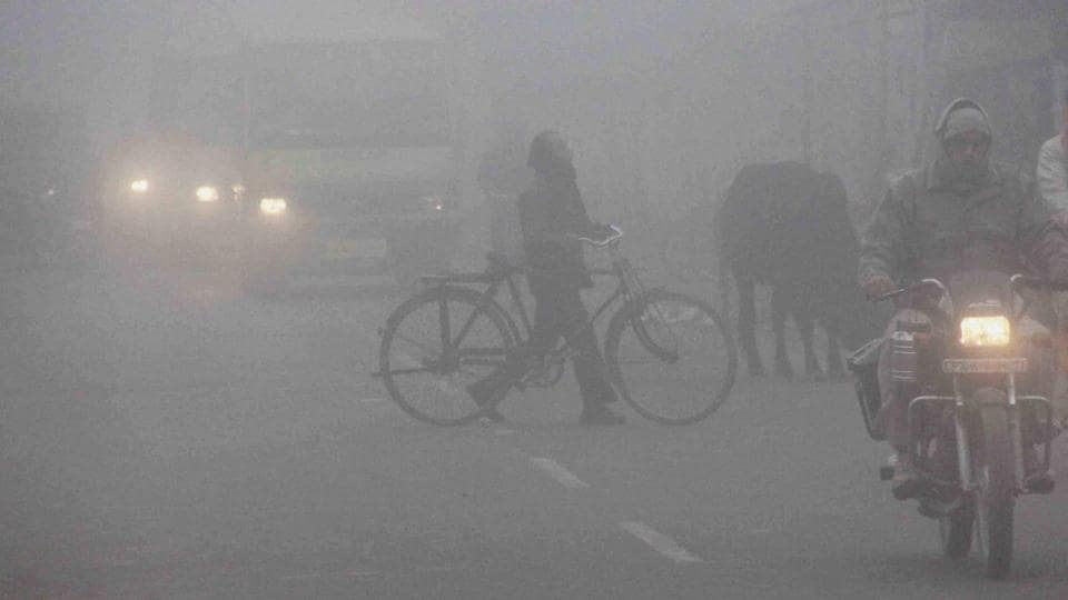 Commuters face a thick blanket of fog in Allahabad.