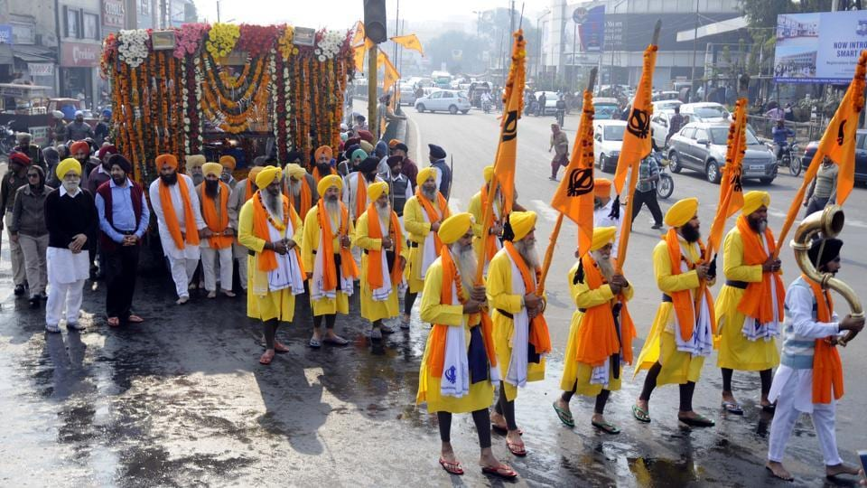 Devotees taking part in Nagar Kirtan on the 350th birth anniversary celebrations of Guru Gobind Singh in Patiala on Wednesday. (Bharat Bhushan  / HT photo)