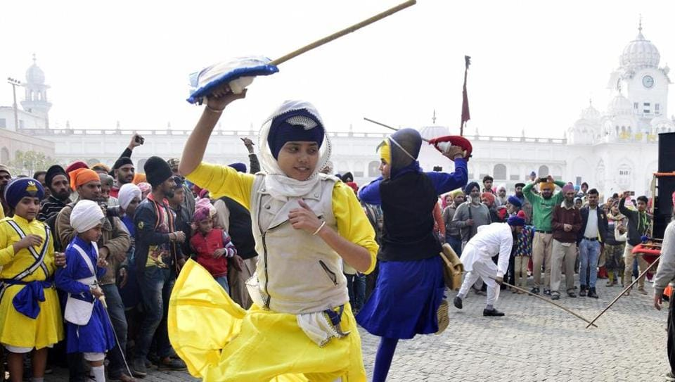 Devotees showcase martial performances during the Nagar Kirtan in Patiala on Wednesday. (Bharat Bhushan  / HT Photo)
