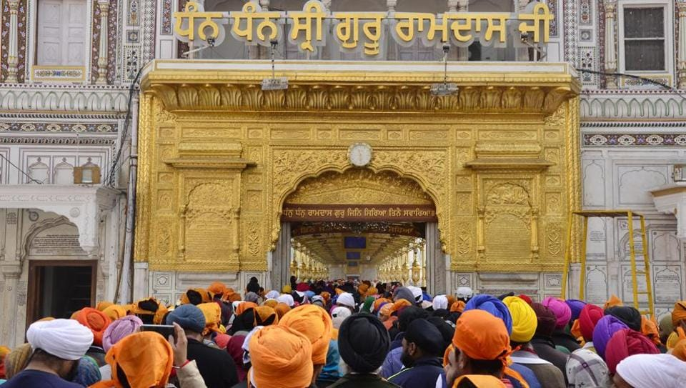 Long queues were witnessed even outside the darshni deori at Golden Temple, where people waited patiently.  (Sameer Sehgal/HT Photo)
