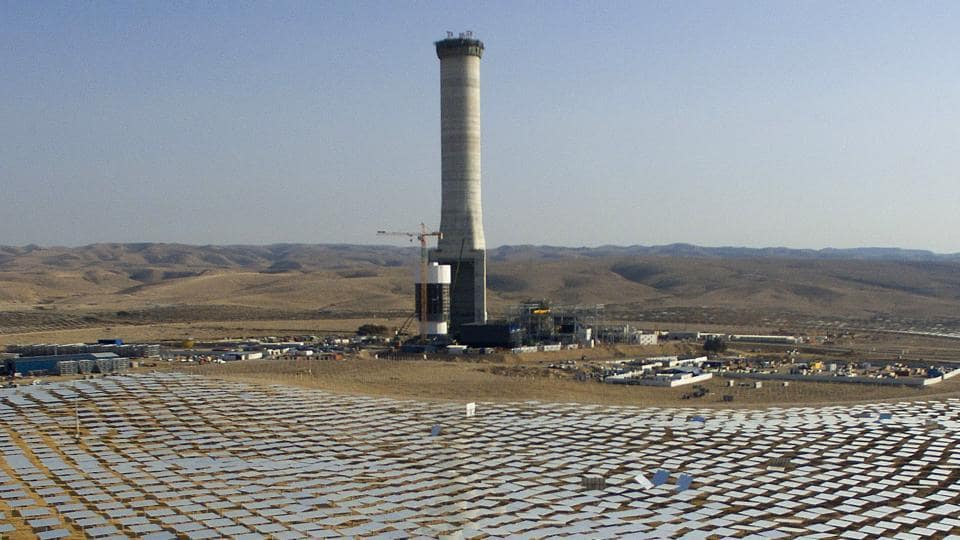 In this Dec. 22, 2016 photo, 50,000 mirrors, known as heliostats,encircle the solar tower in the Negev desert, near in Ashelim, southern Israel.