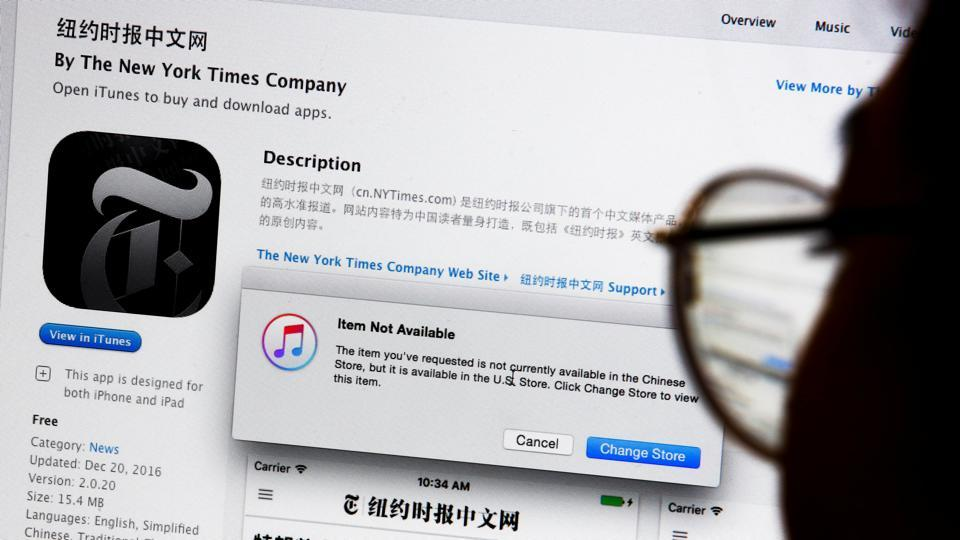 An illustration shows a person looking at a computer screen in Beijing showing an Apple iTunes store message saying that the New York Times app is not available in the Chinese store, in China.