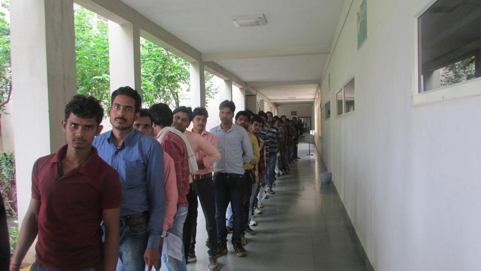 Candidates lined up for police constable recruitment online exam at IES college in Bhopal.