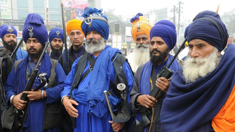 Sikh devotees participate in a Nagar Kirtan, a religious procession taken out on Prakash Parva. (A p Dube / HT photo )