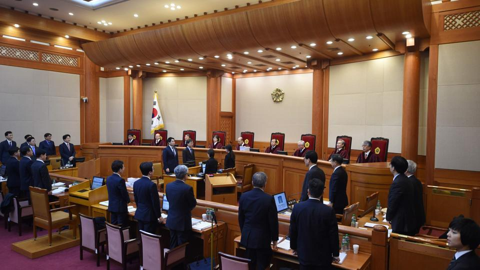 Judges of South Korea's Constitutional Court sit during a hearing on whether to confirm the impeachment of President Park Geun-Hye at the Court in Seoul on January 5, 2017.