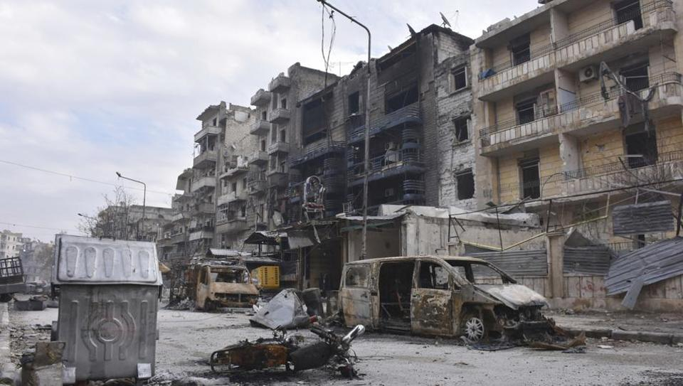 File photo shows damaged buildings and cars in the Ansari neighborhood, east Aleppo.