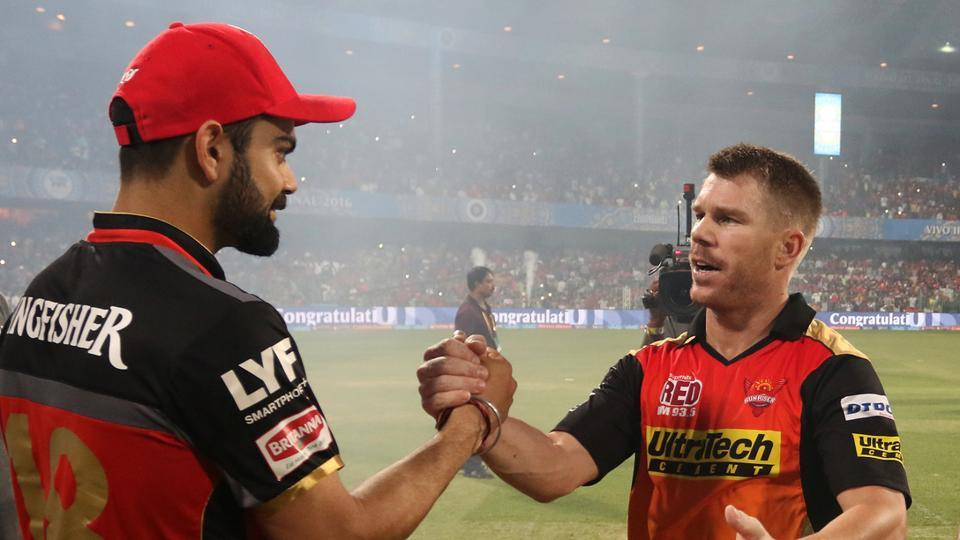 Royal Challengers Bangalore captain Virat Kohli congratulates Sunrisers Hyderabad's victorious captain David Warner after the final of the 2016 Indian Premier League in Bangalore on May 29, 2016.