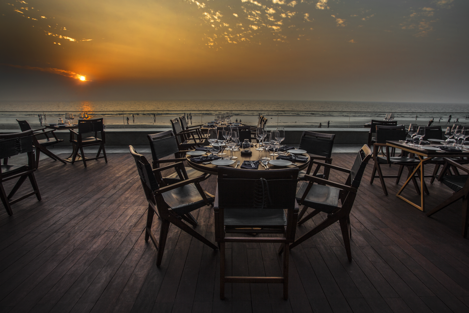 The sundeck seating at Estella offers a scenic view of the ocean.
