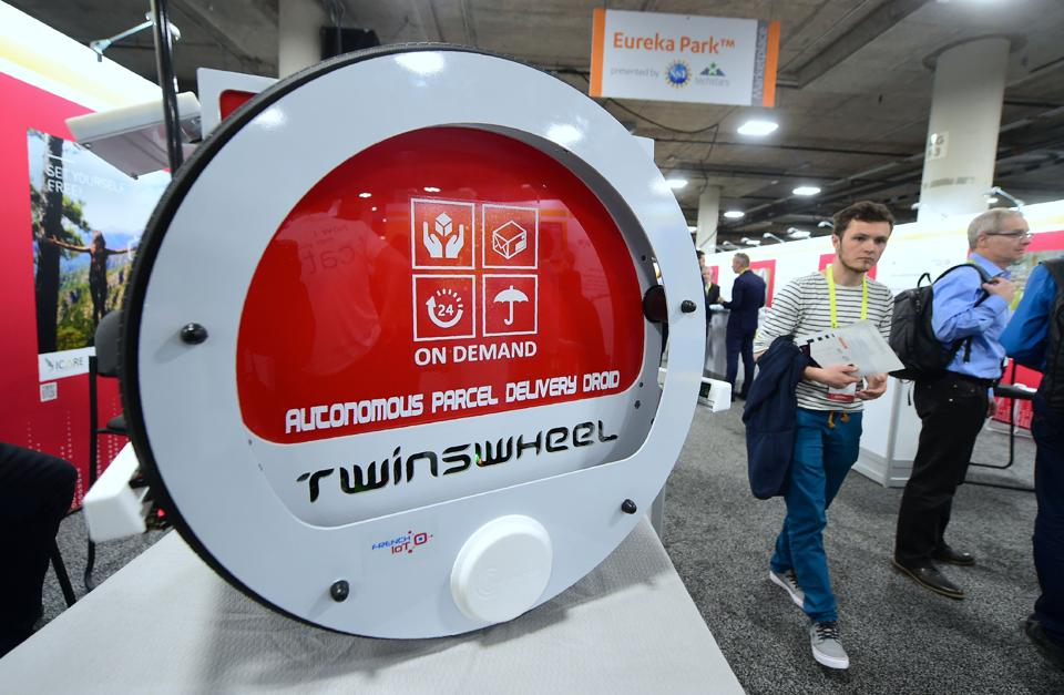 The Twinswheel autonomous parcel delivery droid on display at their booth on the showroom floor during the 2017 Consumer Electronic Show (CES) at the Las Vegas Convention Center in Las Vegas, Nevada. (AFP)