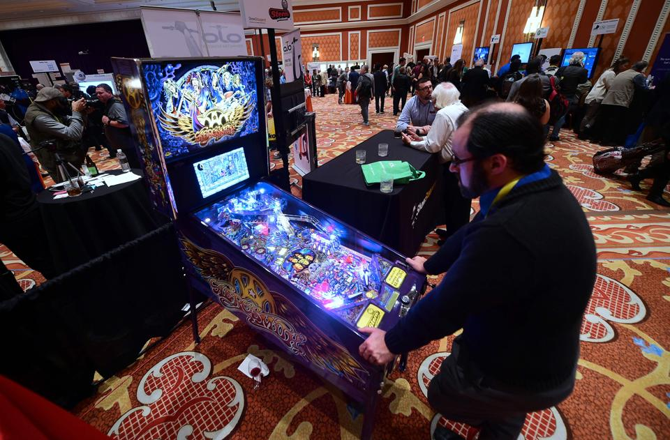 An attendee plays Aerosmith, the newest pinball from Stern Pinball with artwork done by Donnie Danger at Showstoppers during the 2017 Consumer Electronic Show (CES) in Las Vegas, Nevada. (AFP)
