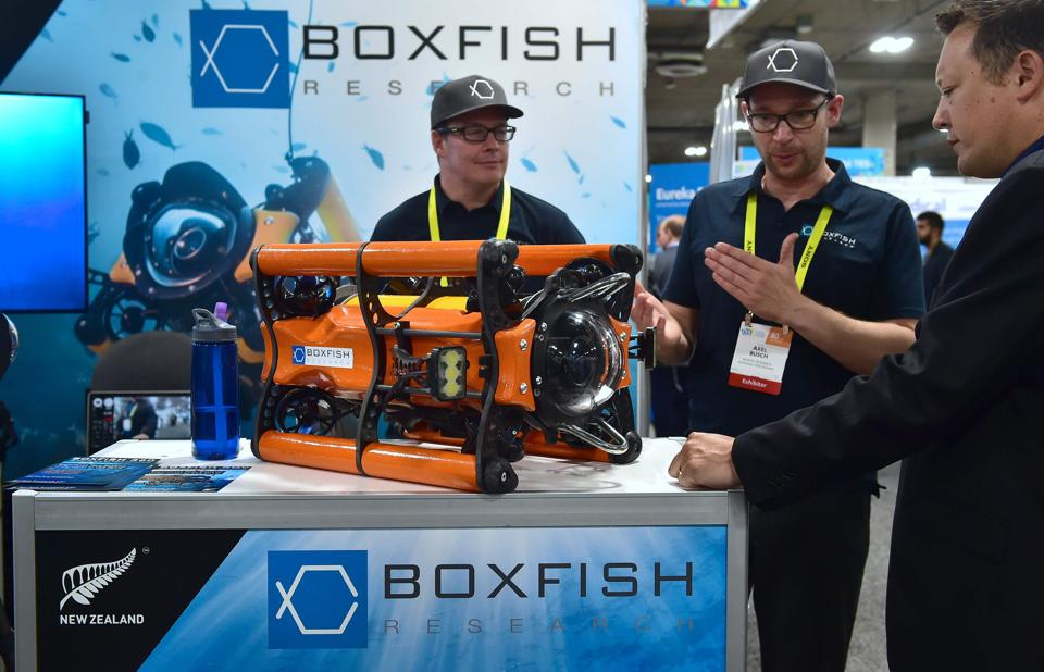 Designers explain the Boxfish Rov, a portable underwater drone for film and science which goes down to 3000 feet while offering live 4k video during the 2017 Consumer Electronic Show (CES) at the Las Vegas Convention Center in Las Vegas, Nevada. (AFP)