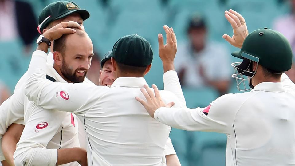 Australia's Nathan Lyon (left) celebrates with teammates after dismissing Pakistan batsman Sharjeel Khan on Day 4 of the third Test match at the SCG in Sydney on Friday. Earlier, David Warner smashed the second fastest 50 in Test history to give Australia a flying start in their chase for runs. The hosts declared at 241-2, setting a victory target of 465 for Pakistan.