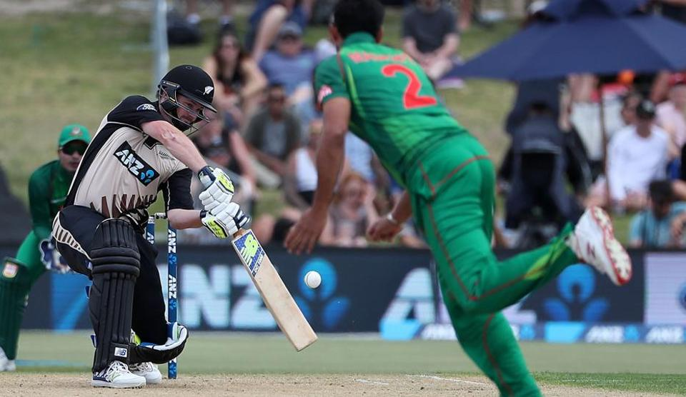 Colin Munro of New Zealand hits a boundary during the second T20 match against Bangladesh at Bay Oval in Mount Maunganui on Friday. Munro hit 101 as NZ beat Bangladesh to clinch the three-match series.