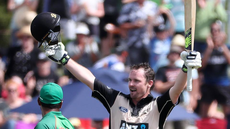 Colin Munro of New Zealand celebrates his 100 runs during the T20 International against Bangladesh at Bay Oval in Mount Maunganui on Friday.