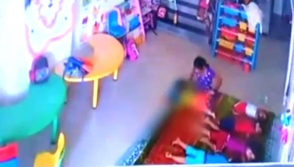 A video grab of the 10-month-old being assaulted at the Kharghar creche by one of its employees.