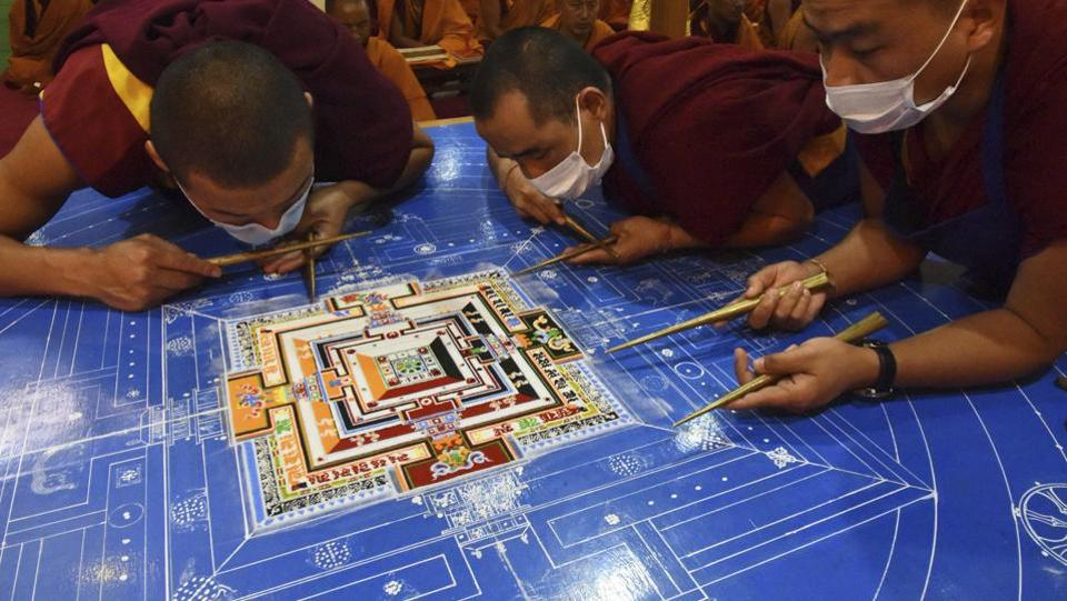 Buddhist monks prepare a Sand Mandala, a spiritual and ritual symbol depicting the Buddhist universe, during the fourth day of Kalachakra in Bodhgaya on Thursday. (AP/AP Photo/Manish Bhandari)